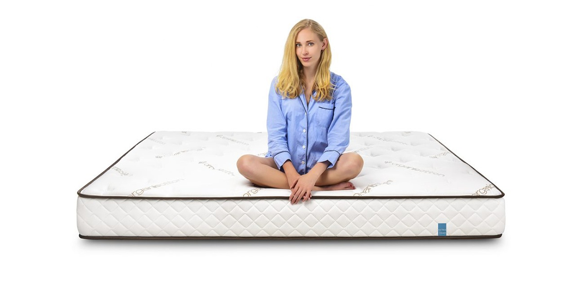 RV Latex Mattress with Model Sitting on Top